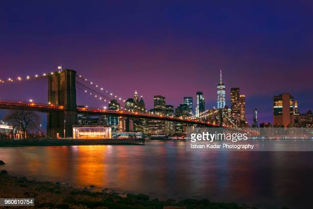 night lights on the brooklyn bridge, manhattan, new york city - brooklyn bridge stock pictures, royalty-free photos & images