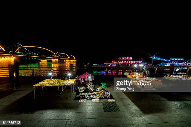 A night market selling North Korea souvenir goods beside the Yalu river Dandong is the largest Chinese frontier city bordering with Sinuiju of North...