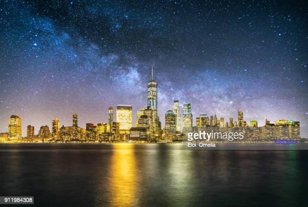 night new york manhattan downtown skyline milky way reflection - world financial center new york city stock pictures, royalty-free photos & images
