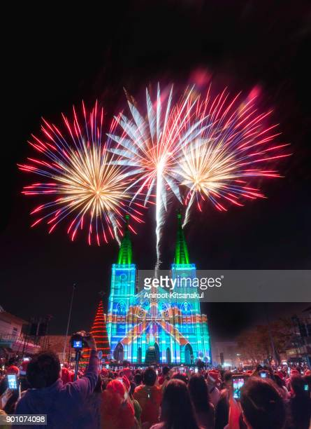a night of christmas celebration at the cathedral of immaculate conception (chanthaburi cathedral). colorful light projection on the cathedral exterior wall, joyful people and christmas tree.christmas fireworks over chanthaburi church, thailand 24/12/2017 - chanthaburi stock pictures, royalty-free photos & images