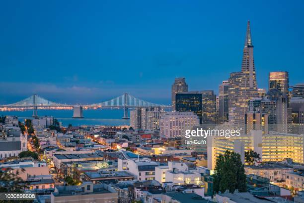 night over san francisco downtown and bay bridge from ina coolbrith park, usa (dusk) - san francisco california stock photos and pictures