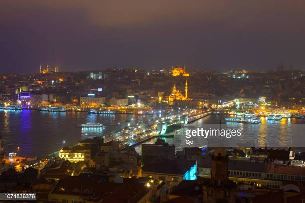 Night panoramic view on the Golden Horn and Galata Bridge in Istanbul