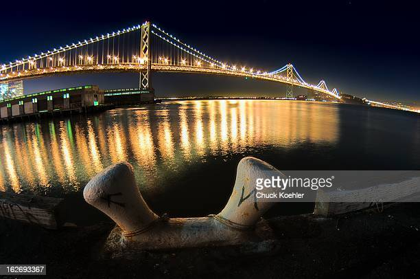 Night photo of a Boat Tie Down in front of the Bay Bridge in San Francisco, California.