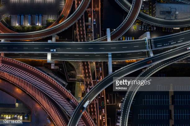 night photograph of complicated intersecting highway. - yokohama stock pictures, royalty-free photos & images