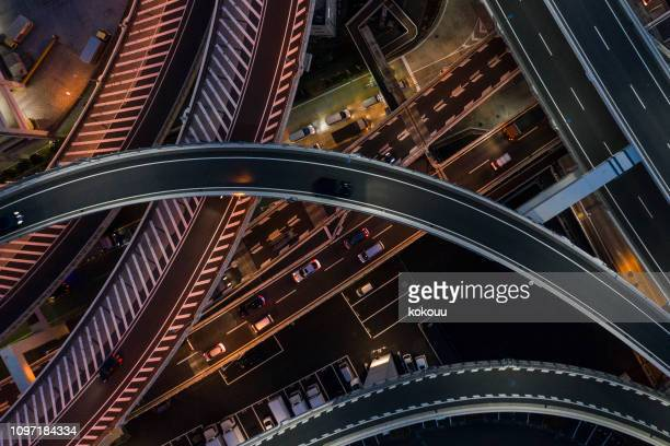 night photograph of complicated intersecting highway. - change stock pictures, royalty-free photos & images