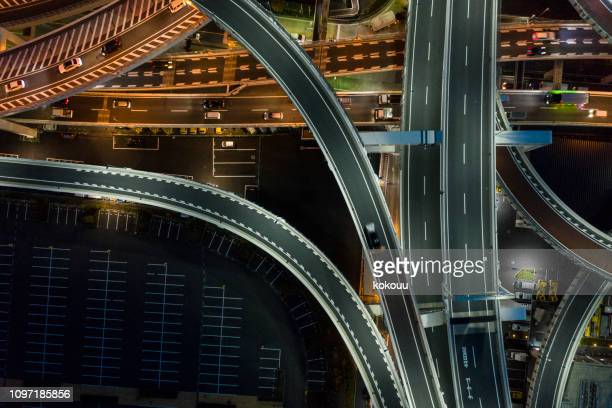 night photograph of complicated intersecting highway. - highway stock pictures, royalty-free photos & images