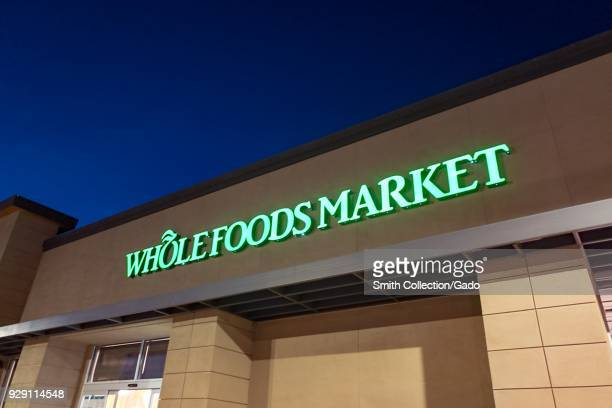 Night Photograph Of Sign With Logo On Facade Whole Foods Market Upscale Grocery Store Acquired
