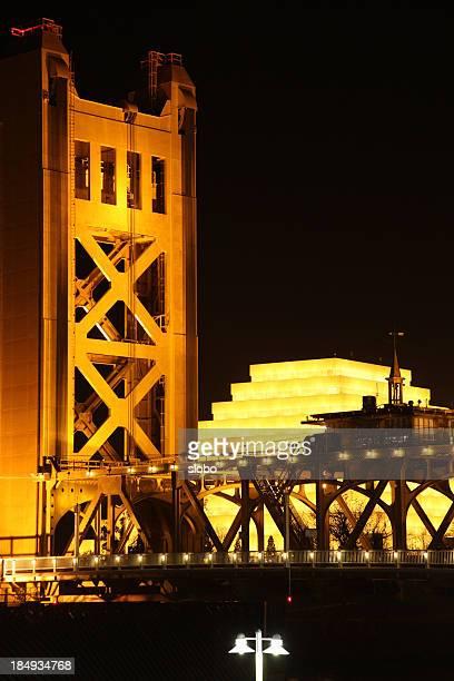 night photograph of the sacramento landmark bridge - ziggurat stock photos and pictures