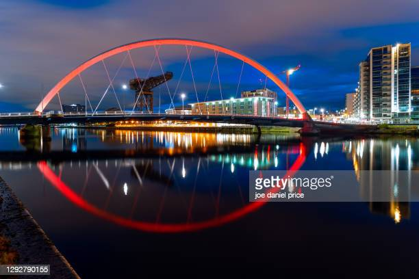 night, reflection, clyde arc, glasgow, scotland - international landmark stock pictures, royalty-free photos & images