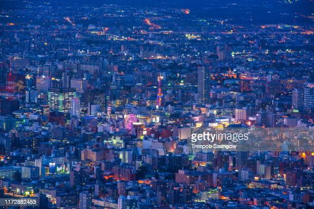 night scape of sapporo city - sapporo stock pictures, royalty-free photos & images