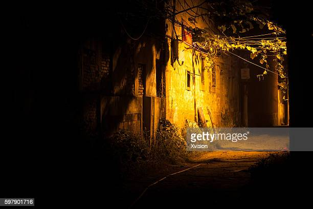 night scence of the abandoned area wenchangli in fuzhou city,china - black alley stock photos and pictures