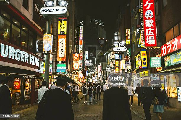 night scene in the streets of shibuya - shibuya ward stock pictures, royalty-free photos & images
