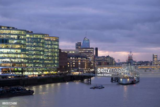 Night scene looking over the River Thames towards HMS Belfast and More London area offices and business district in London United Kingdom This area...