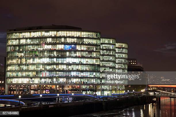 Night scene looking over the River Thames towards More London area offices and business district This area is a recent development which is now...