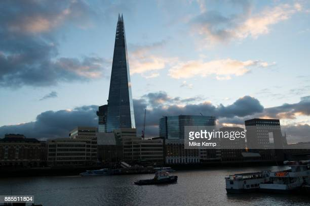 Night scene looking over the River Thames towards the Shard and More London area offices and business district in London United Kingdom This area is...
