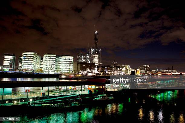 Night scene looking over the River Thames towards the skyline of More London area offices and business district This area is a recent development...