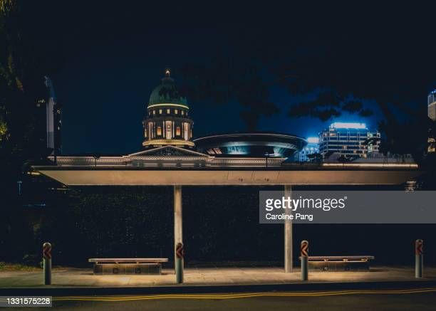 night scene of a bus stop - rotunda stock pictures, royalty-free photos & images