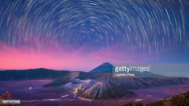 night scene of bromo national park with startrails - mt bromo stock photos and pictures