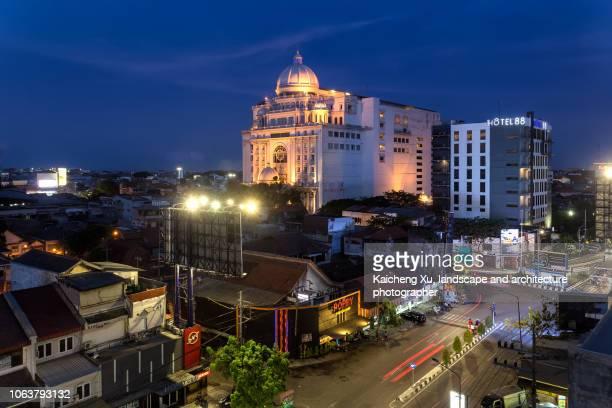 night scene of empire palace in surabaya,east java,indonesia - surabaya stock pictures, royalty-free photos & images