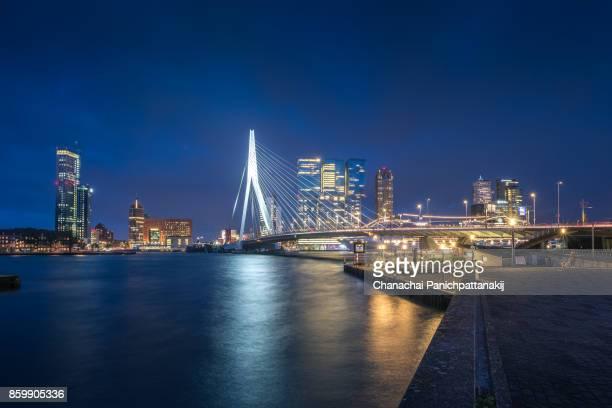 Night scene of Erasmus Bridge crossing Nieuwe Maas River in Rotterdam, The Netherlands
