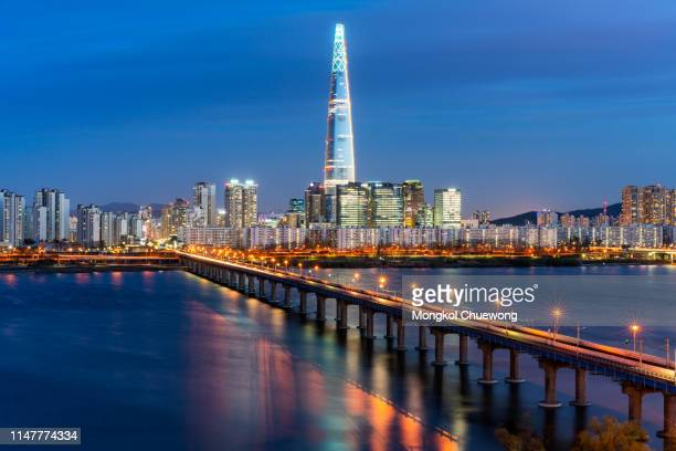 Night scene of Seoul downtown city skyline, Aerial view of Seoul cityscape and light trails of traffic at Han river bridge in twilight sky in sunset in Seoul city, South Korea