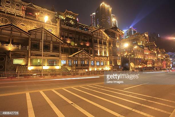 Night scene of street and bright buildings in Chongqing Hongya Cave