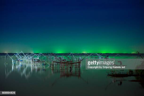 Night scene of the square dip nets in the Talay Noi lake, Phattalung province, Thailand.