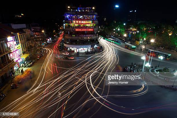 Night scene of traffic trails in the Old Quarter overlooking Hoan Kiem Lake