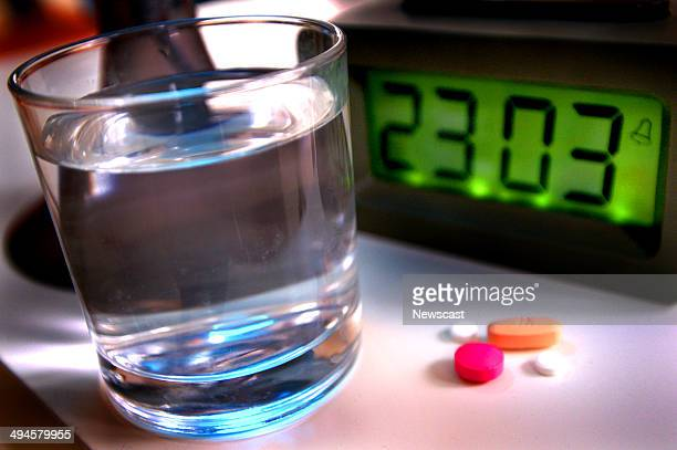 A night scene with a selection medication and a glass of water