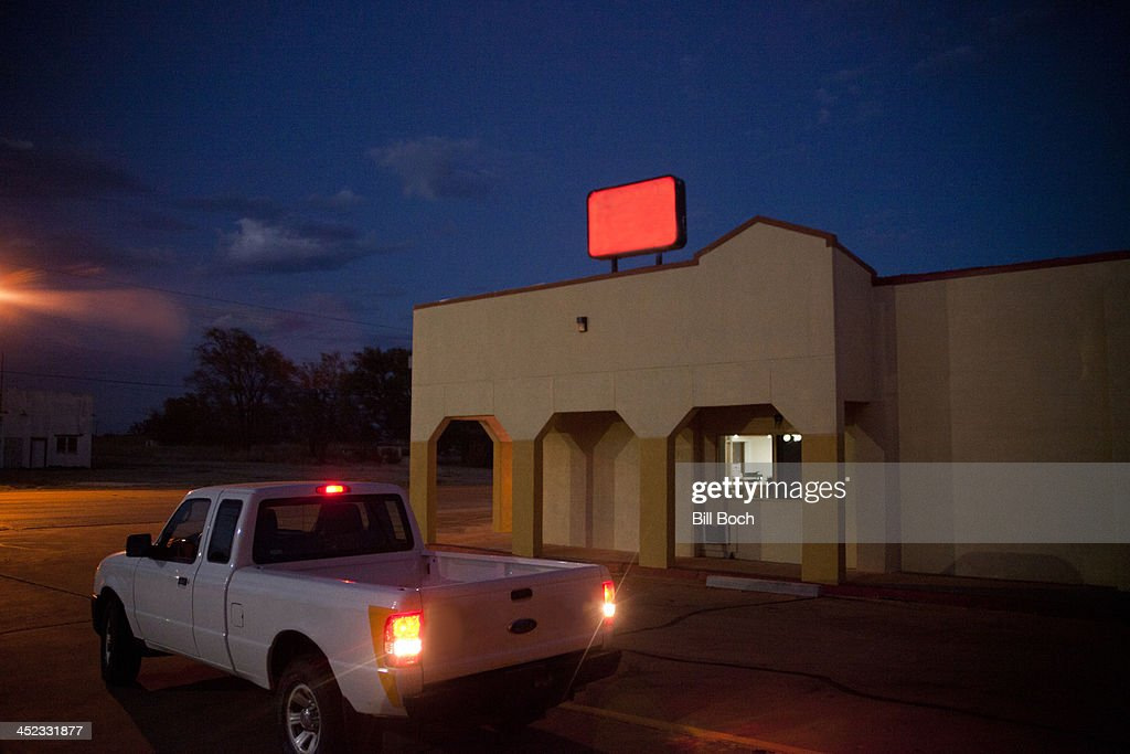 Night scene with truck and no name sign : Stock Photo