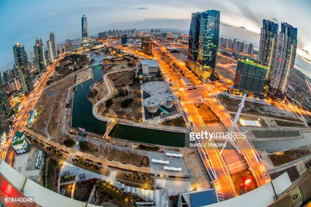night scenery of central park in songdo international business district - songdo ibd stock pictures, royalty-free photos & images