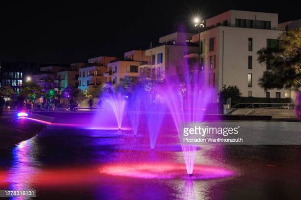 night scenery of outdoor colorful illuminated lighting on canal for festival of light at green center essen in essen, germany. - installation art stock pictures, royalty-free photos & images