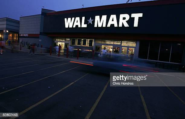 Night settles in on a 24hour WalMart May 11 2005 in St Louis County Missouri WalMart America's largest retailer and the largest company in the world...