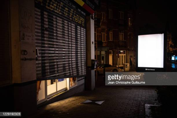 Night shop owner is forced by government measures to close at 10 p.m. On October 20, 2020 in Brussels, Belgium. Bars and restaurants in Brussels have...