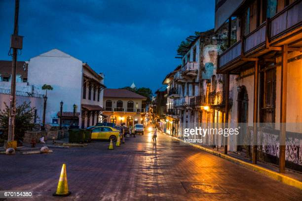 Night shot of Casco Viejo also called Casco Antiguo, Panama City's Old Quarter established in 1673, with its old buildings and an unrecognizable person in background.