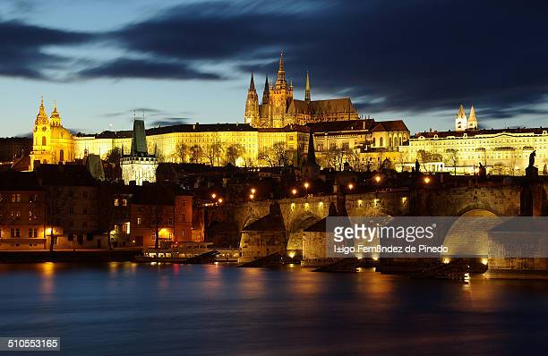 Night shot of Charles Bridge and Old Town Prague background. The Charles Bridge is the oldest bridge in the Prague, Vltava river and through the Old...