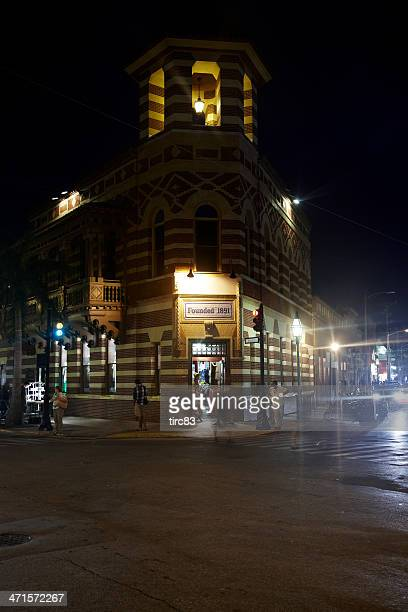 night shot of duval street corner in key west - duval street stock pictures, royalty-free photos & images