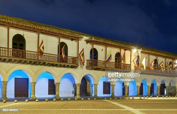 "night shot of flags of Cartagena at historical facade of town hall ""Alcaldia Mayor"""