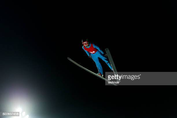 Night Shot of Ski Jumper in Mid-air