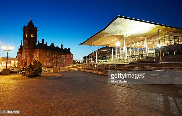night shot of the senedd and pierhead building. - national assembly stock photos and pictures
