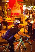 night shot young thai woman cycling