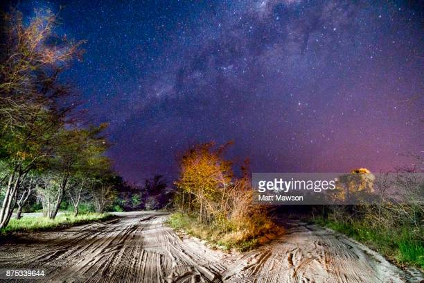 night sky and the milky way in botswana the southern hemisphere - southern hemisphere stock photos and pictures