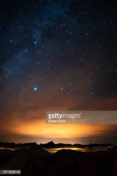 night sky in the mountains with light pollution - dramatic sky stock pictures, royalty-free photos & images