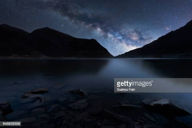 night sky mountain lake and milky way galaxy - atmospheric mood stock pictures, royalty-free photos & images