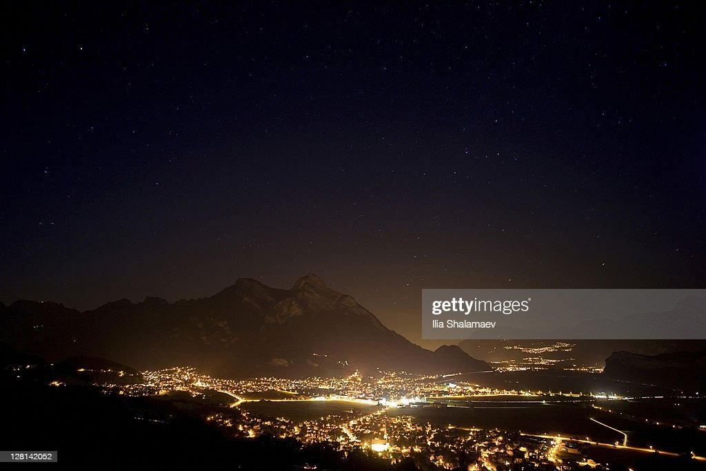 Night sky over Rhein valley that separates Liechtenstein and Switzerland : Stock Photo