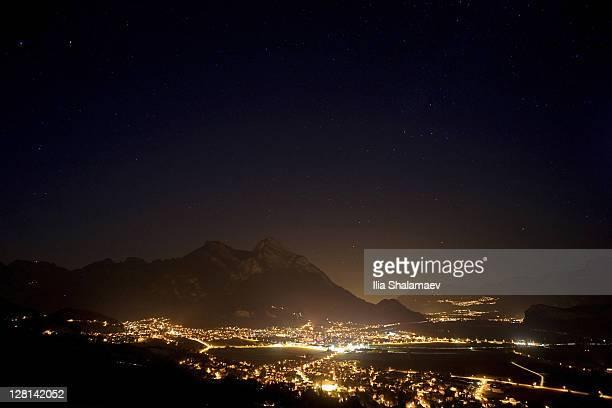 Night sky over Rhein valley that separates Liechtenstein and Switzerland