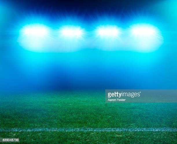 night stadium grass - stadium lights stock photos and pictures