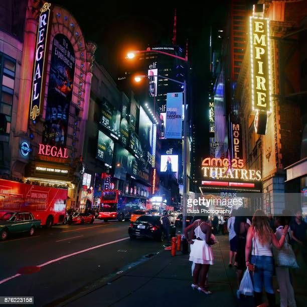 Night street scene in Midtown Manhattan: Marquees of 42nd Street, including AMC25 Empire Theaters and the Regal Cinemas. New York City, USA