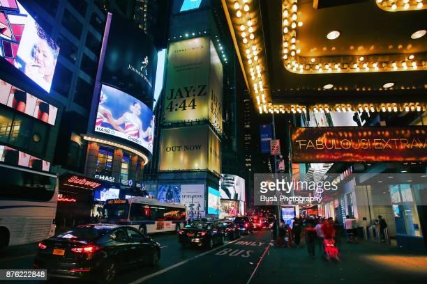 Night street scene in Midtown Manhattan: traffic along 42nd Street. New York City, USA