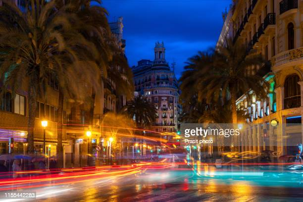 night street view in valencia downtown, spain. palm trees in spanish city of valencia. - valencia fotografías e imágenes de stock